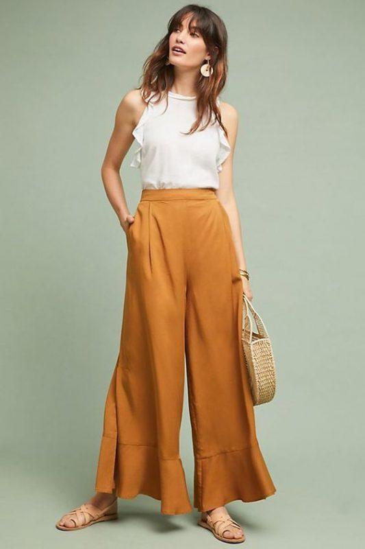 outfits con pantalones palazzos y sandalias planas