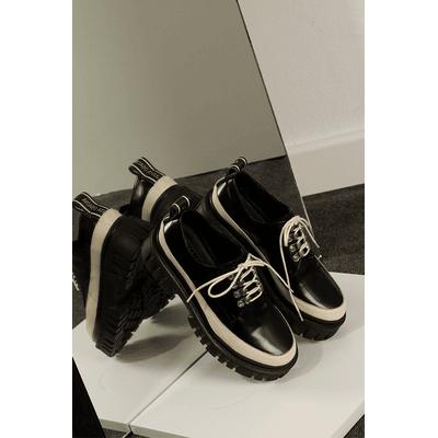 zapatos abotinados Justa Osadia